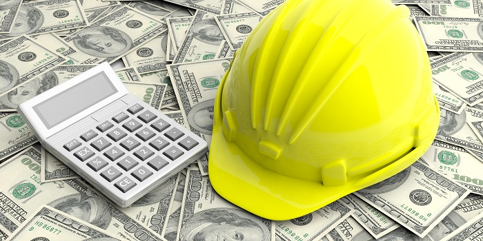 Construction helmet and calculator on dollars banknotes background. 3d illustration